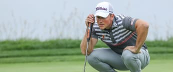 Enoch eases into second round lead