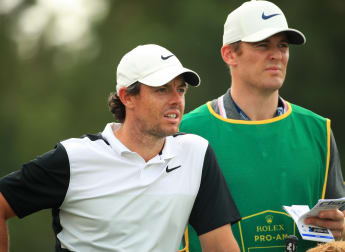 McIlroy calm in caddie's absence