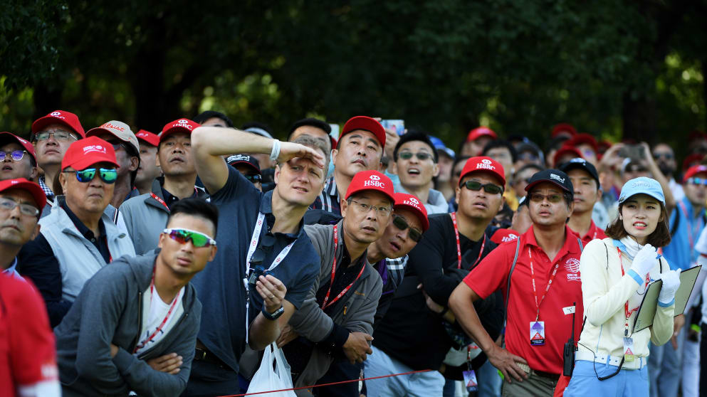 Fans watch play during the third round of the WGC - HSBC Champions